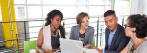 Header - Employee Benefits Going Over Benefits in a Meeting
